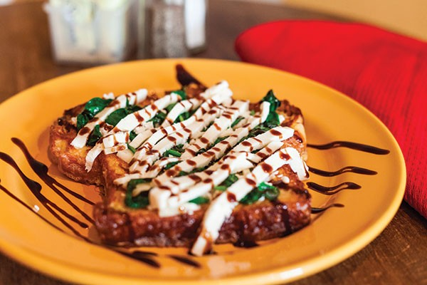 Spanikopita French toast: baby spinach, feta, asiago and fresh mozzarella, drizzled with a balsamic glaze - PHOTO BY VANESSA SONG