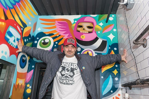 Painter Matt Spahr with one of his commissioned murals inside Downtown's Tako restaurant - PHOTO BY AARON WARNICK