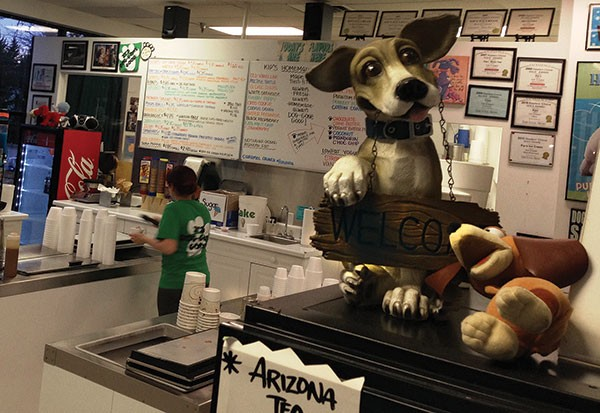 Dog statuettes welcome you into ice-cream paradise. - PHOTO BY RYAN DETO