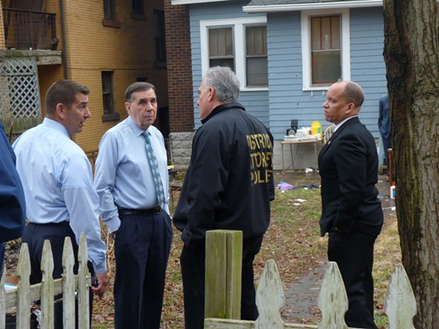 Officials meet outside the scene of a mass shooting in the Pittsburgh suburb of Wilkinsburg on March 10. - PHOTO BY REBECCA NUTTALL