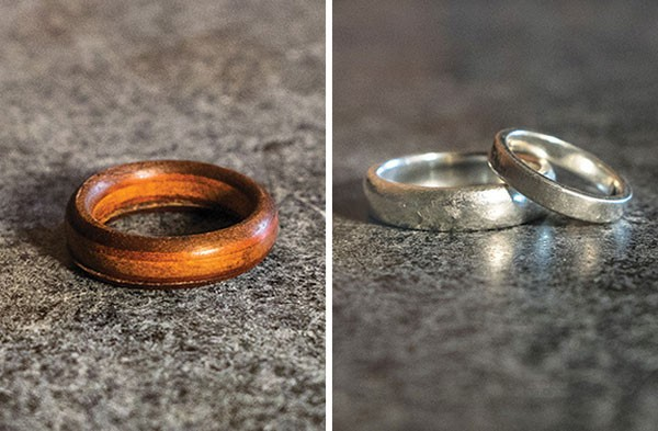 Amy and Ian Green's original $35 wooden wedding ring, and their custom-made silver wedding bands