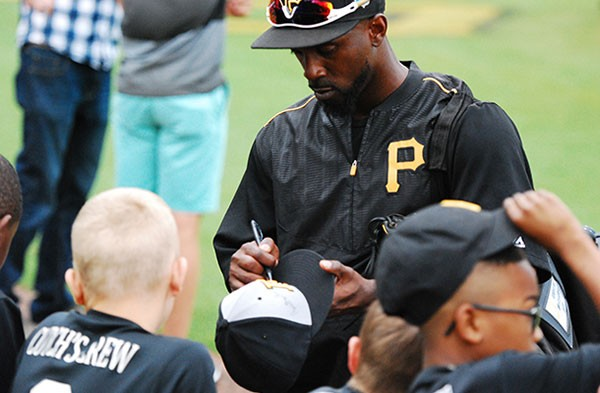 Andrew McCutchen signs autographs for kids at Pirates spring training in Bradenton, Florida - PHOTO BY CHARLIE DEITCH