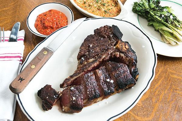 Porterhouse steak with Romesco sauce, carrots au gratin and grilled escarole