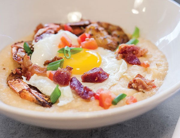 Bakn: Pan Seared Shrimp & Grits from Bakn: Creamy cheddar grits, applewood smoked bakn, scallion, tomato and sunnyside egg