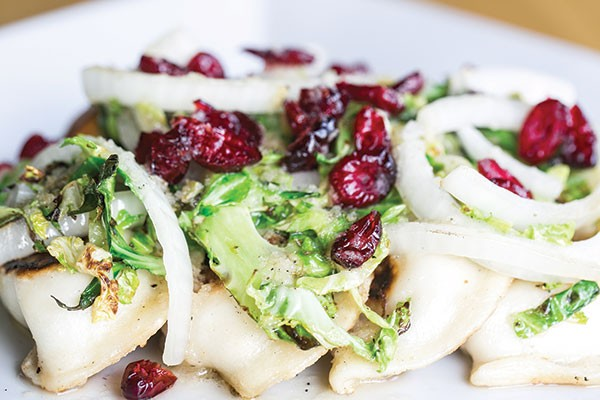 Pierogi with grilled onions, cranberries, Brussels sprouts and apple vinaigrette