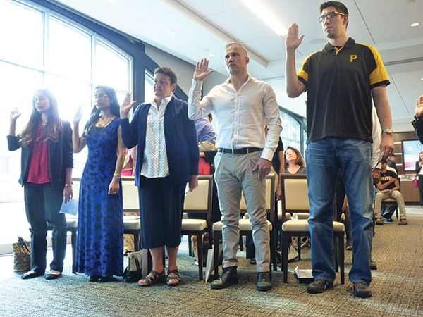 New American citizens being sworn in at PNC Park