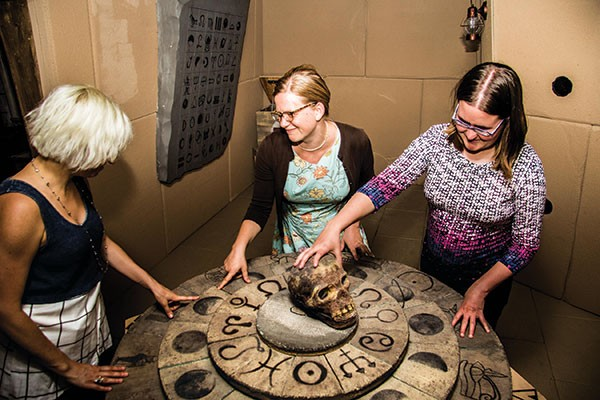 Getting a clue: from left, Leslie Scheunemann, Janel Hanmer and Anna Zemke play Tomb Explorer at Escape Room Pittsburgh.