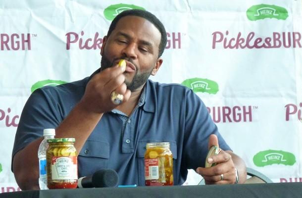 Jerome Bettis sampling a pickle chip - PHOTO BY RYAN DETO