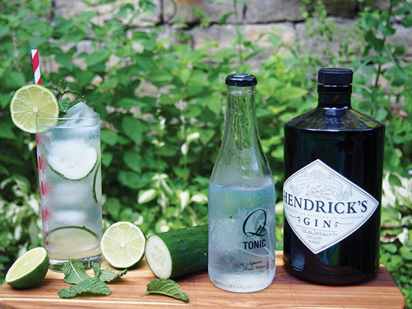 A gin-and-tonic, garnished with cucumber, lime and mint, is a refreshing summer cocktail.