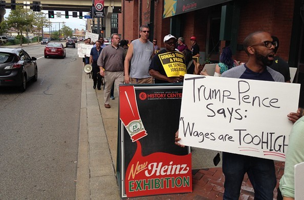 Protesters march at the entrance to yesterday's Mike Pence event at Heinz History Center - CP PHOTO BY RYAN DETO