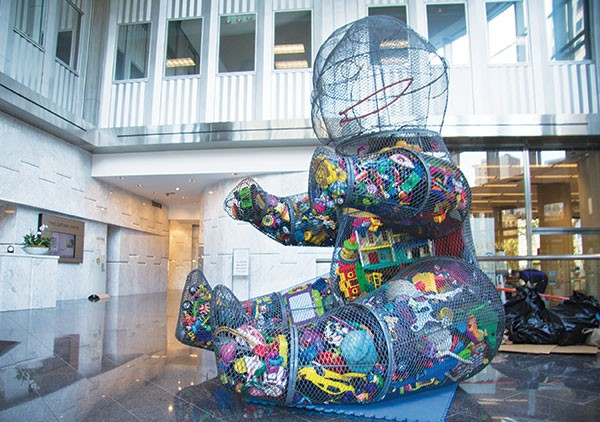 "Joyce Dallal's wire sculpture ""The Other Toy Story"" (it's filled with discarded toys), in Two Gateway Center"