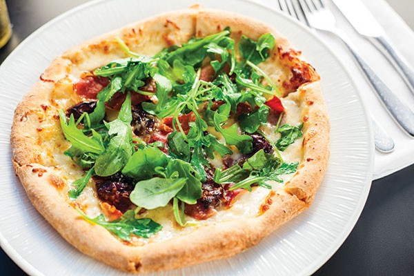 Prosciutto flatbread with dates, arugula and white truffle