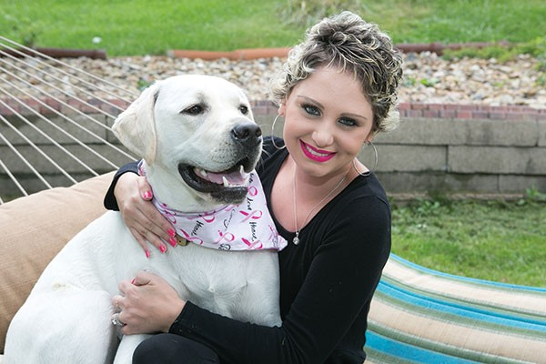 Meghan Koziel with her dog Tizzy - CP PHOTO BY JOHN COLOMBO