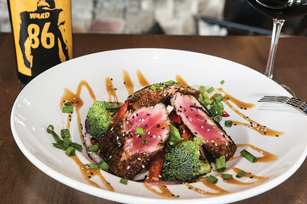 Blackened thick-cut ahi tuna, with a light caramel drizzle, served with rice and stir-fried vegetables