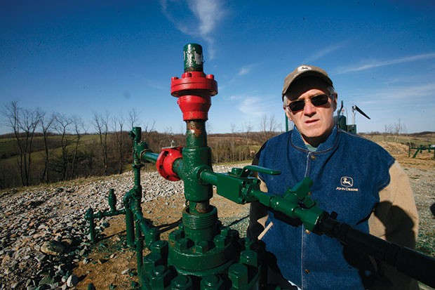 Ron Gulla stands at the site of one of four natural-gas wells on his property in Hickory, Pa. in 2009 - CP FILE PHOTO