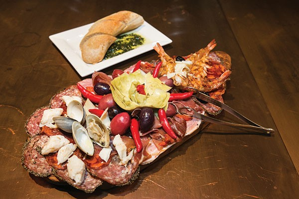 Seafood antipasti: assorted Italian meats, cheeses, olives, vegetables and seafood
