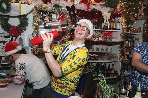 Bartender Elliott Sussman shaking cocktails