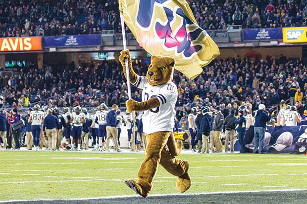 Pitt's Mascot runs through the endzone at Yankee Stadium Dec. 28 in front of a sea of Pitt fans who travelled to support their team - PHOTO COURTESY OF UNIVERSITY OF PITTSBURGH ATHLETICS MEDIA RELATIONS