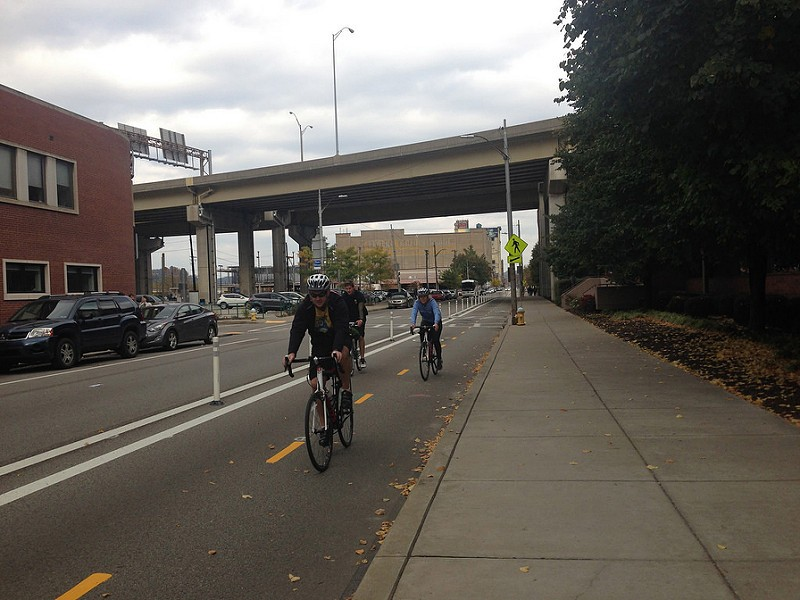 Bike riders on Penn Avenue protected bike lane - PHOTO COURTESY OF BIKE PITTSBURGH