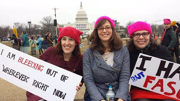 Kara Kernan, Holly Anderton and Marie Rivera-Johnson, all from Pittsburgh, rallied with their signs at the Women's March on Washington. - CP PHOTO BY KIM LYONS
