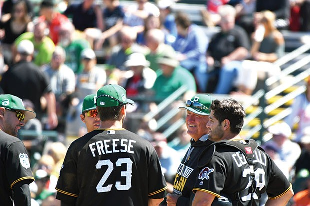 Pittsburgh Pirates manager Clint Hurdle chats with his infield during a pitching change March 17 - CP PHOTO BY CHARLIE DEITCH