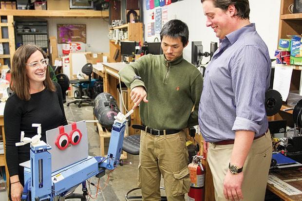 Meredith Grelli, John Choi and Chris Moehle test the malting robot. - PHOTO COURTESY OF JOHN TARASI