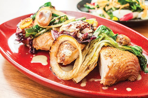 Wood-roasted Locust Point chicken with hearty greens, sweet onion salad and schmaltz vinaigrette