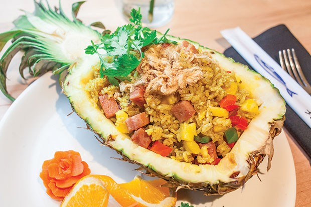 Pineapple curry stir-fried white rice with ham and bell peppers