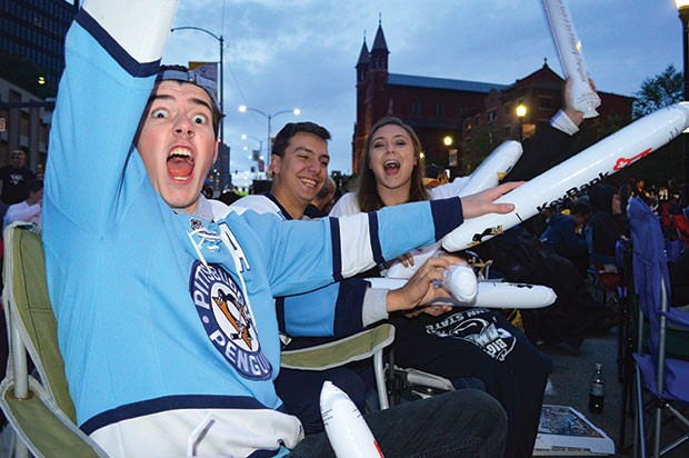 Fans outside PPG Paints Arena during a recent Penguins Playoff game - CP PHOTO BY JORDAN MILLER