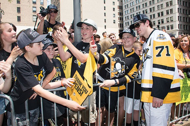 Evgeni Malkin poses with fans during the Penguins' 2017 Stanley Cup parade. - CP PHOTO BY JORDAN MILLER