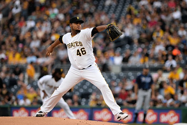 Starting pitcher Ivan Nova deals in the first inning. Nova allowed two runs over five innings. - CP PHOTOS BY JOHN HAMILTON