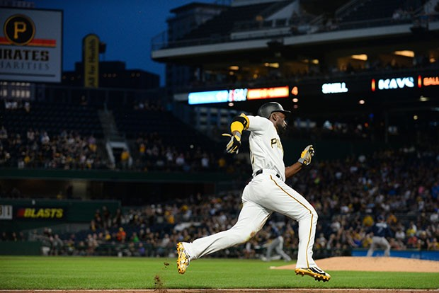 Andrew McCutchen rounds third headed for his first run of the evening.