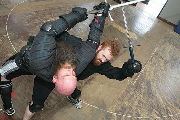 Two Broken Plow martial artists dueling with German longswords