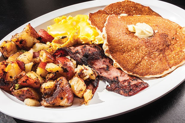 Al's Special: Pancakes, bacon, home-fries and cheese eggs