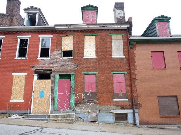 4 Seneca St. in Uptown has been owned by Bob Eckenrode since 2004. The property's doors and windows are boarded up, and it has sat vacant for years. - CP PHOTO BY RYAN DETO