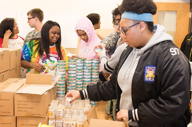 Students from Perry High School help organize the food pantry - CP PHOTO BY JAKE MYSLIWCZYK