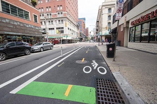 Protected bike lane on Penn Avenue, Downtown - CP PHOTO BY JAKE MYSLIWCZYK