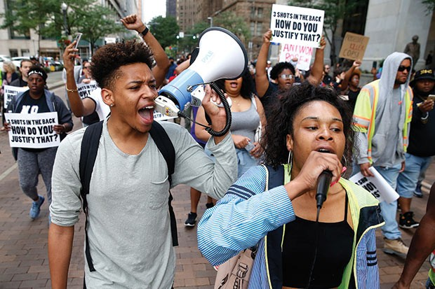 Protesters calling for police reform - CP PHOTO BY JARED WICKERHAM