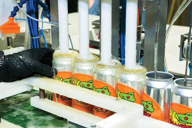 East End Brewing fills cans of Bigger Hop DIPA - CP PHOTO BY JOHN COLOMBO