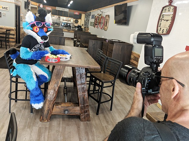 Behind the scenes: Photographer John Colombo poses Rika in Furryland - CP PHOTO BY LISA CUNNINGHAM