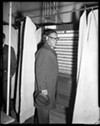 Teenie Harris' photo of activist and politician K. Leroy Irvis voting in Pittsburgh in 1962