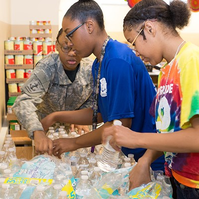 Perry High School librarian Sheila May-Stein and her students at work in the in-school food pantry
