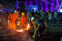 SIzzling iron pours captivate festival goers. - Uploaded by wuycheck