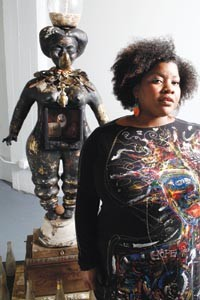 "Vanessa German with her sculpture ""The Tioga Street Soul Queen."" - HEATHER MULL"