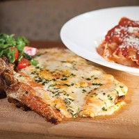 Veal chop Parmigiana for two: breaded, bone-in chop, served with <i>mafalda</i> tossed with tomato sauce