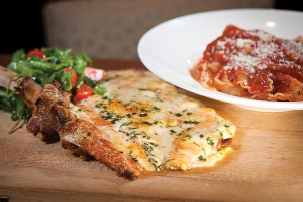 Veal chop Parmigiana for two: breaded, bone-in chop, served with mafalda tossed with tomato sauce