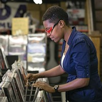 Vinyl fantasy: Dave's customer Carmen Brown flips through the racks.