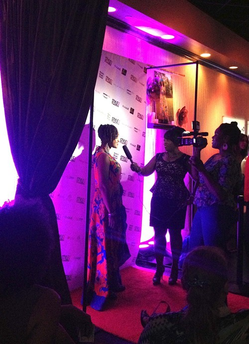 Wadria Taylor on the red carpet wearing a dress designed by Lana Neumeyer