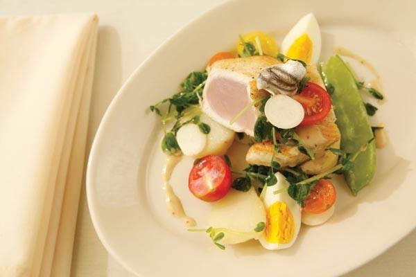Wahoo with potato, hard-boiled egg, white anchovy, cherry tomato, hakurei turnip and vinaigrette