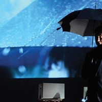 Weathering the storm: David Cabot in Point Park Rep's <i>The Umbrella Man</i>.